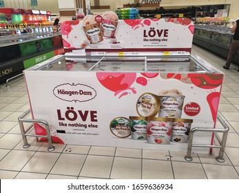 Bukit Tinggi, Malaysia - 23 February 2020 : HAAGEN DAZS ice cream freezer display in the supermarket with selective focus.