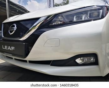 Bukit Tinggi Pahang,Malaysia - 24 Julai, 2019: Metallic White Nissan Leaf at Aurel Sanctuary Galery Bentong Pahang, compact five-door hatchback electric car manufactured by Nissan.