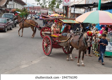 BUKITTINGGI, INDONESIA - DEC 22, 2013: Carriage on the street. Bukittinggi is the second biggest city in West Sumatra. It is located near the volcanoes Mount Singgalang and Mount Marapi