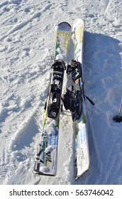 BUKOVEL, UKRAINE - December 2, 2016: Ski with Bukovel sign on ski slope. Bukovel is the most popular ski resort in Ukraine.