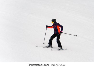 BUKOVEL, UKRAINE - FEB 4, 2018: Unidentified tourist does skiing downhill in Bukovel, the largest ski resort in Eastern Europe
