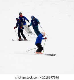BUKOVEL, UKRAINE - FEB 5, 2018: Unidentified group of tourists does skiing in Bukovel, the largest ski resort in Eastern Europe