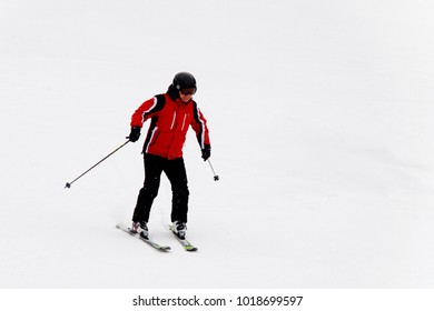 BUKOVEL, UKRAINE - FEB 5, 2018: Unidentified tourist does skiing in Bukovel, the largest ski resort in Eastern Europe