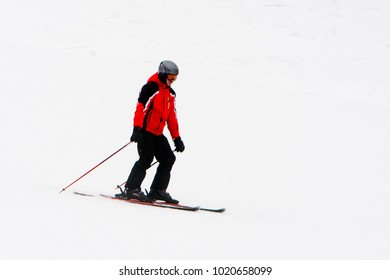 BUKOVEL, UKRAINE - FEBRUARY 5, 2018: Unidentified tourist does skiing in Bukovel, the largest ski resort in Eastern Europe
