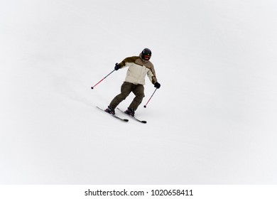 BUKOVEL, UKRAINE - FEBRUARY 5, 2018: Unidentified tourist does skiing downhill the mountain in Bukovel, the largest ski resort in Eastern Europe