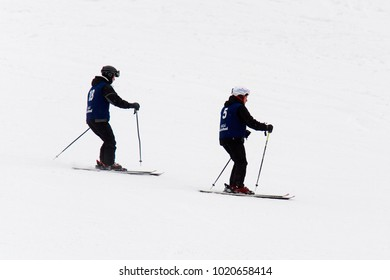 BUKOVEL, UKRAINE - FEBRUARY 5, 2018: Unidentified group of tourists does skiing in Bukovel, the largest ski resort in Eastern Europe