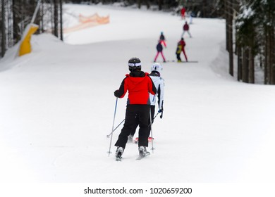 BUKOVEL, UKRAINE - FEBRUARY 5, 2018: Unidentified tourist does skiing in Bukovel, the largest ski resort in Eastern Europe