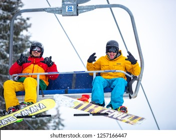BUKOVEL,UKRAINE-19 MARCH,2018: Chair lift for skiers and snowboarders at winter resort.Elevator for active tourists who ride on snowboards & skis at Bukovel Winter Park in Carpathian mountains