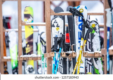 BUKOVEL,UKRAINE-19 MARCH,2018: Stand with rental skis at Bukovel Winter Park resort for tourists in Southern Europe. Professional mountain ski equipment for active tourism