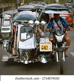 Bulacan, Philippines - December 30 2017: A typical tricycle scene in the Philippines.