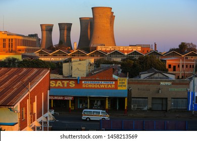 Bulawayo, Zimbabwe – August 21, 2016: The sun rises illuminating the Bulawayo Power Station and the adjacent neighborhood.