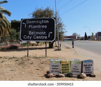 Bulawayo, Zimbabwe. August 9th 2015. Zimbabwe newspapers headlines posters on display in Bulawayo. Belmont City Centre.