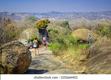 Bulawayo, Zimbabwe, September 11, 2016: Tourists walking among the rocks in Matobo National Park.