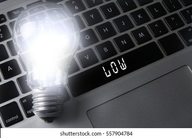 Bulb and black keyboard with innovation and strategic conceptual words.