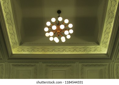 the bulb chandelier installed at the ceiling coffer with concealed LED indirect lighting