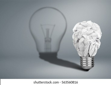 Bulb with crumpled paper and shadow, Idea creative concept on grey