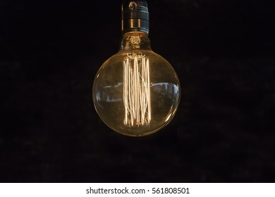 Bulb in front of black wall
