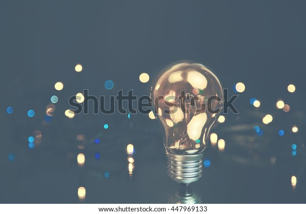 bulb light stand alone with many bokeh