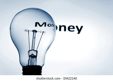 bulb and money text showing concept of financial success