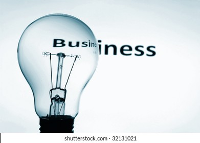 bulb on blue background showing business concept with copyspace
