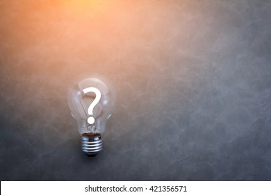 bulb with question mark on grey color background