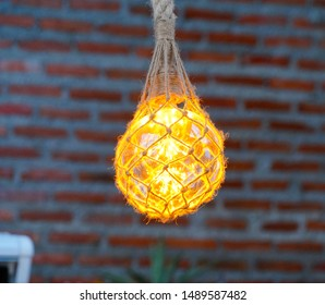 Bulb with rope for decorative interior. The design of lighting, an unusual light bulb, it different ideas for coffee shop. Dark interior room.