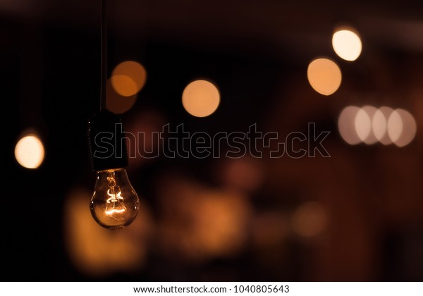 bulb in soft background of warm, muted light