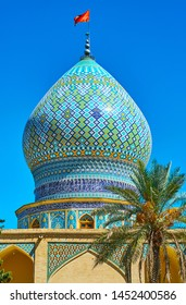 The bulbous dome of medieval Ali Ibn Hamzeh Holy Shrine, decorated with tile geometric patterns in blue gamma and carved details, Shiraz, Iran