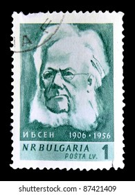 """BULGARIA - CIRCA 1956: A stamp printed in Bulgaria shows Henrik Ibsen with the inscription """"Ibsen, 1906-1956"""" from the series """"Great cultural anniversaries, 1956"""", circa 1956"""