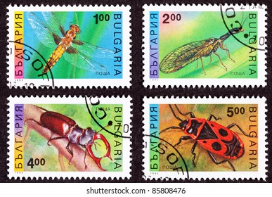 BULGARIA - CIRCA 1993:  Four stamps printed in Bulgaria show a dragonfly, mayfly, stag beetle, and a carrion beetle, circa 1993.
