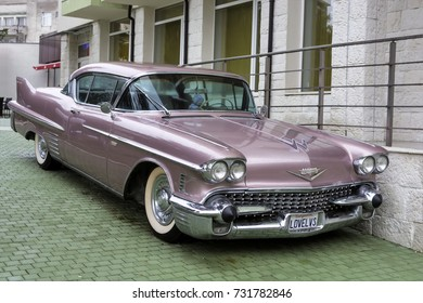 Bulgaria, Elhovo - October 07, 2017 : Pink Cadillac Series 62 Coupe 1958 Badge  whit  V-8 engine, automatic transmission and air conditioning inside. The Cadillac was owned by Elvis Presley.