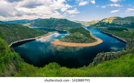 Bulgaria, Kurdjali dam, aerial view of meander in Arda river, surrounded with green forest, summer time