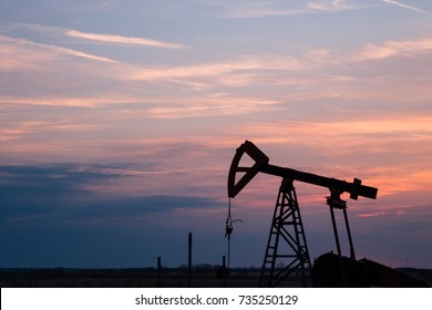 Bulgaria, Shabla - Sunset view of a oil pumpjack