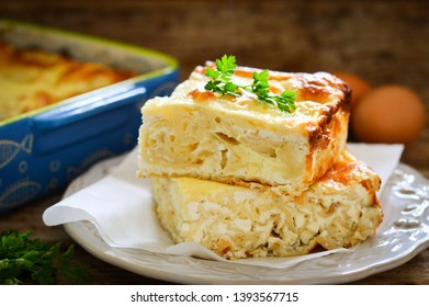 Bulgarian pie Banitsa with cheese. Wooden background