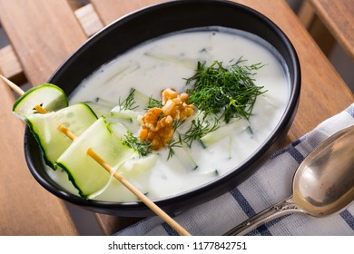 Bulgarian Tarator - traditional summer chilled vegetable soup with yogurt, cucumbers, greens, walnuts