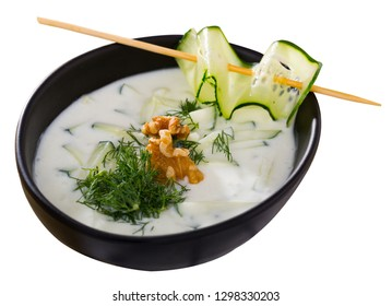 Bulgarian Tarator - traditional summer chilled vegetable soup with yogurt, cucumbers, greens, walnuts. Isolated over white background