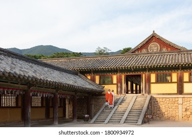 The Bulguksa Temple in Gyeongju-si, Korea- August, 2020 : Two monks are going up the stairs