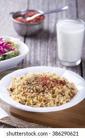 Bulgur with ayran and salad.selective focus on wooden background , kuskus