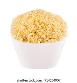 Bulgur groats in white bowl, closeup, isolated. Template for menu, cover, advertising.