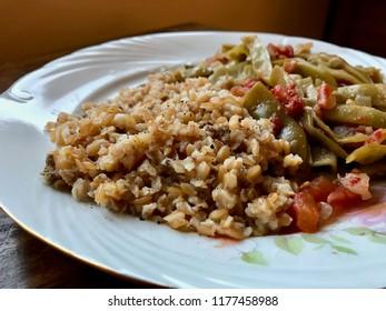 Bulgur Rice made with Siyez Unu Einkorn Flour (Triticum monococcum) with Green Beans Zeytinyagli Fasulye / Pilav or Pilaf