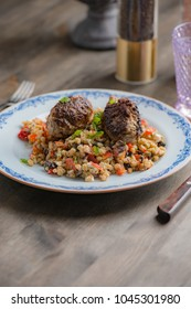 Bulgur salad with lamb patties