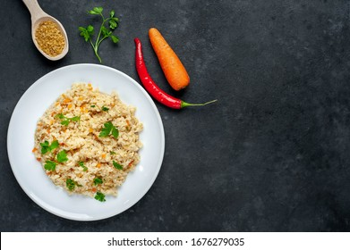 Bulgur with vegetables on a stone background with copy space for your  text. Healthy eating