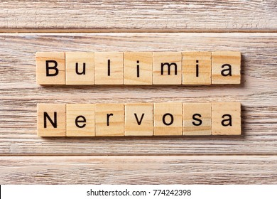 BULIMIA Nervosa word written on wood block. BULIMIA Nervosa text on table, concept.