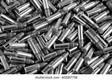 Bulk .22 caliber ammunition, black and white background.