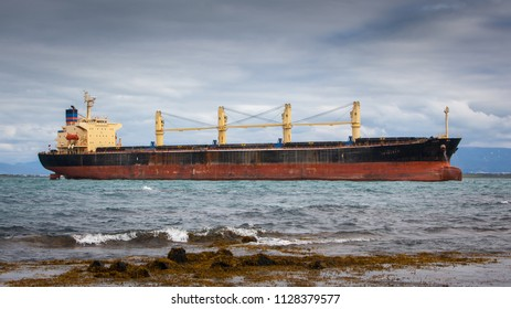 Bulk carrier sailing near shore