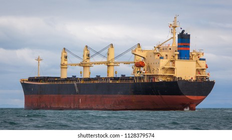 Bulk carrier sailing to the open Atlantic ocean.