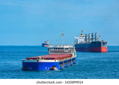 Bulk carrier vessels at outer anchorage of Kamsar port, Guinea, West Africa.