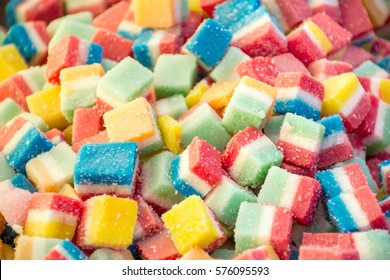 Bulk of colorful gummy jello candy cubes