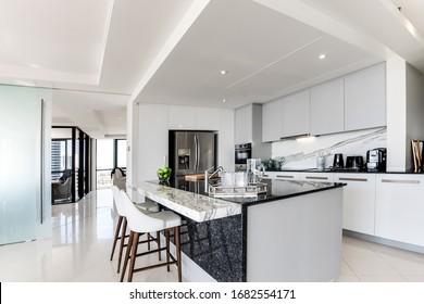 Bulk head inside a modern kitchen with stone bench
