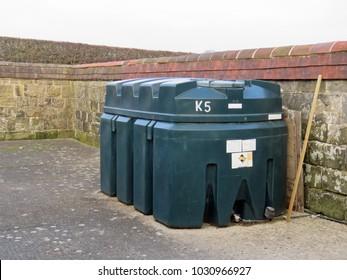 Bulk Plastic fuel oil storage tank in a small court yard